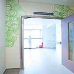 Looping green waves in the theatre corridor